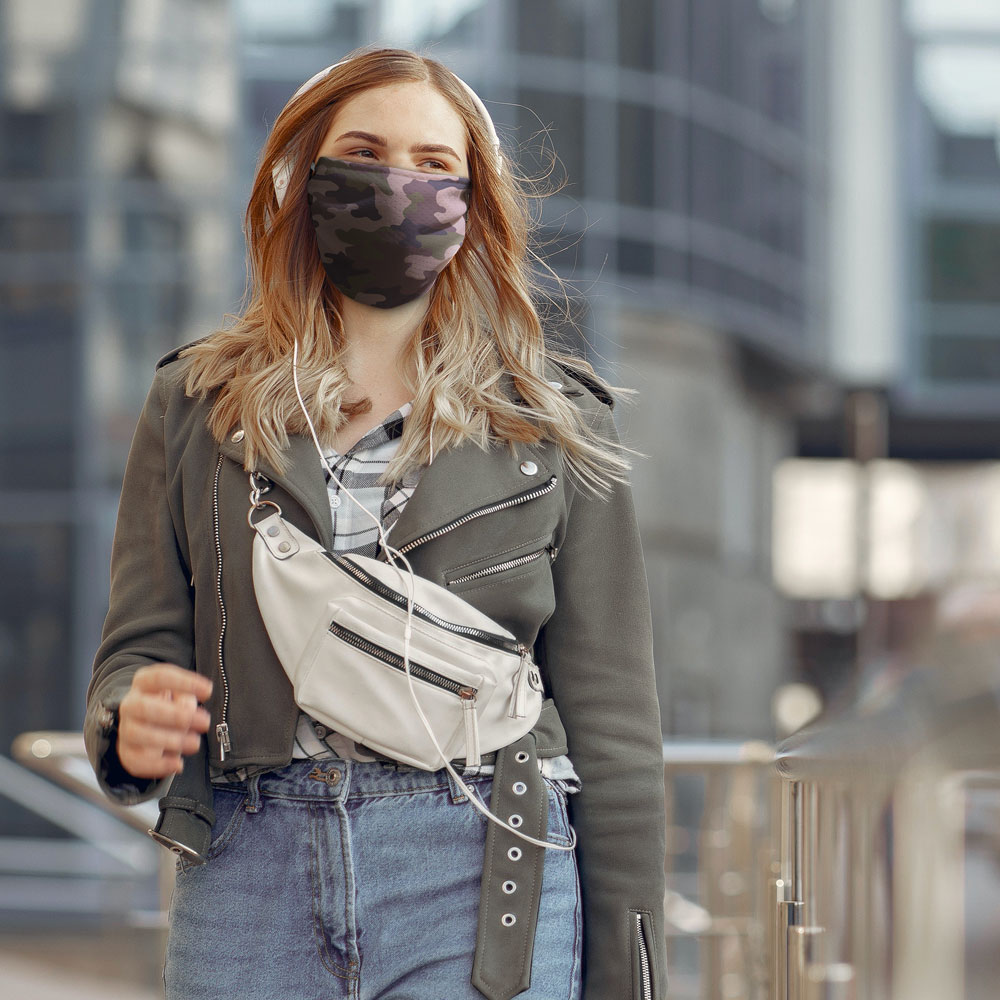 A person walking wearing a custom camo face mask